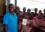Children receive their new storybooks.
