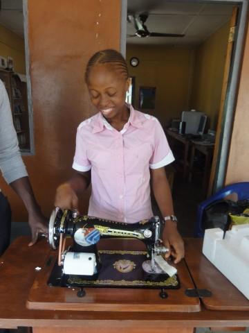Elizabeth Examines a New Sewing Machine