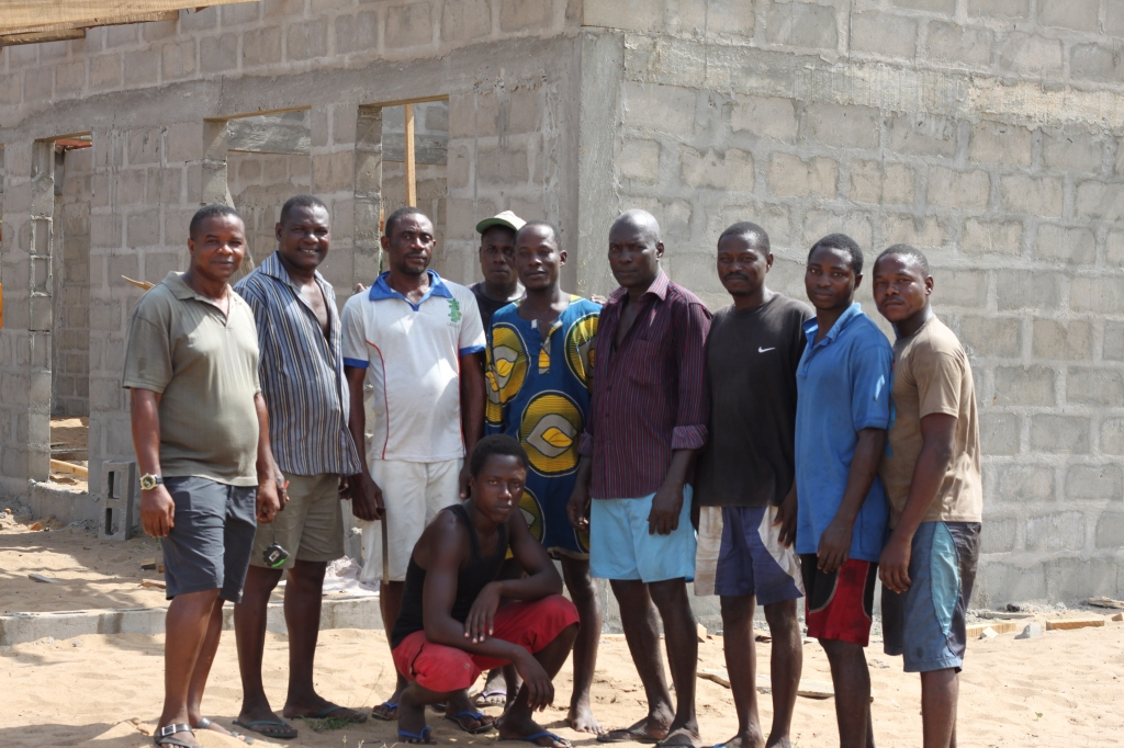 Ben O'Wa's construction crew poses in front of the new classroom building.