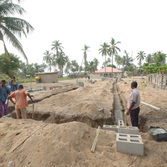 Workers set the foundation for the new classroom building at Ishahayi.