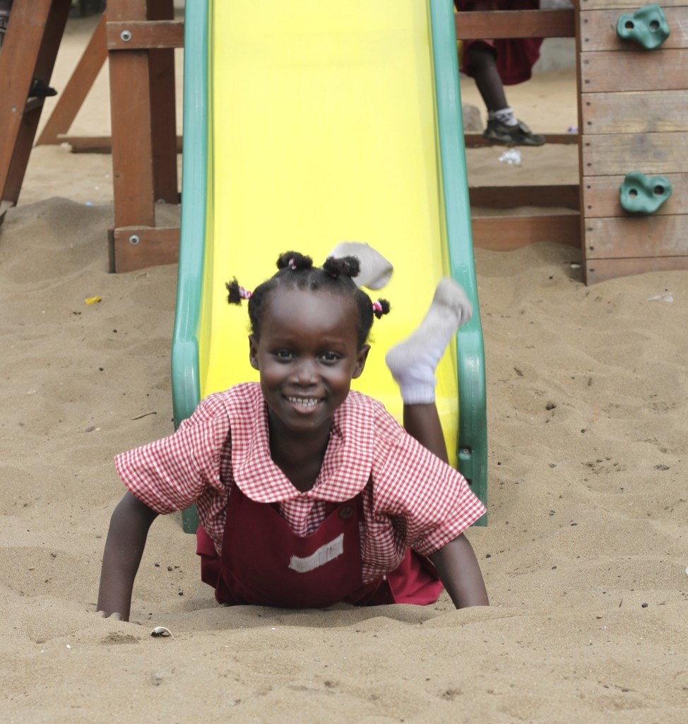 A student enjoys the new playground equipment installed at The Light School.