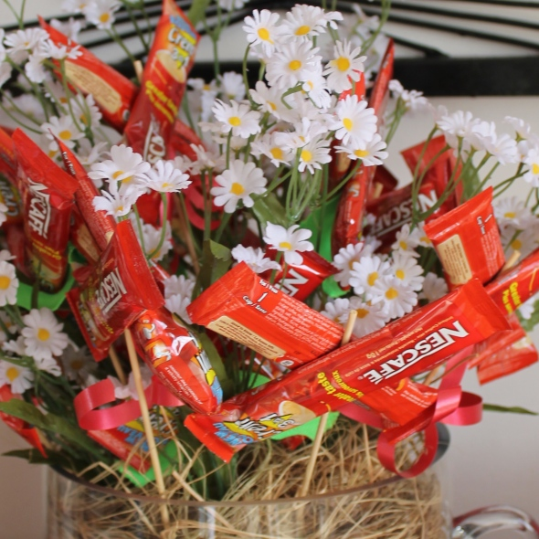 A bouquet of Nescafe packets greets attendees at IBSF's Kitchen Shower.