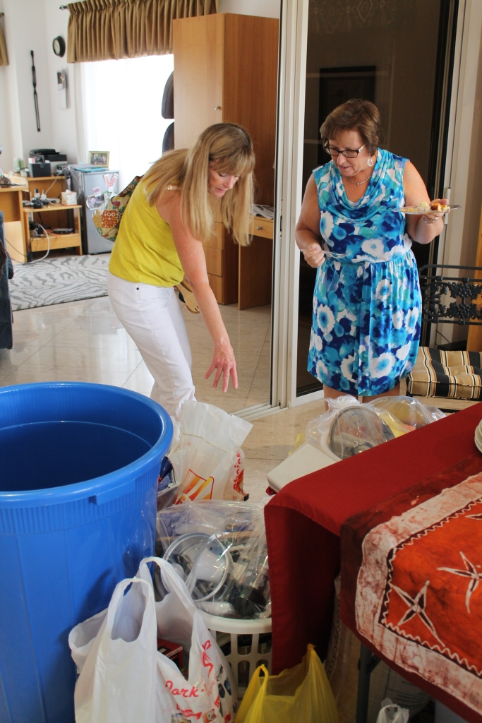 Sherry Lory and Robbin Unietis admire the donations brought to the Kitchen Shower!