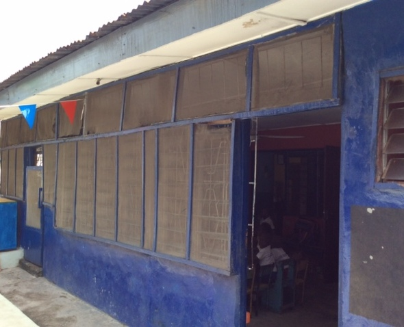 Before: damaged screening and broken window panes at Ife Oluwa.
